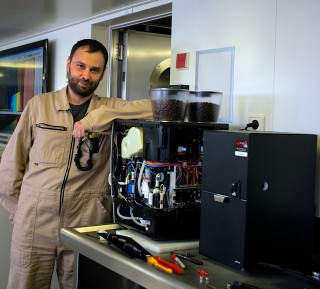 Todor Gerasimov doing maintenance work on Falkor's main coffee machine, which is almost as critical as the scientific equipment.