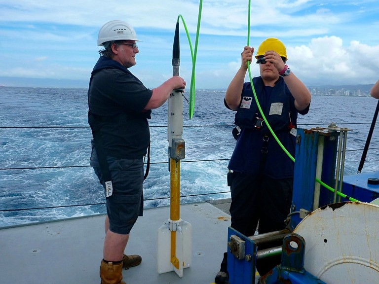 Marine technicians Peter Keen and Colleen Peters deploying the magnetomter during an earlier expedition.