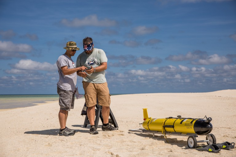 Scientists Angelos Mallios and Rich Camilli calibrate the compass of an AUV glider.