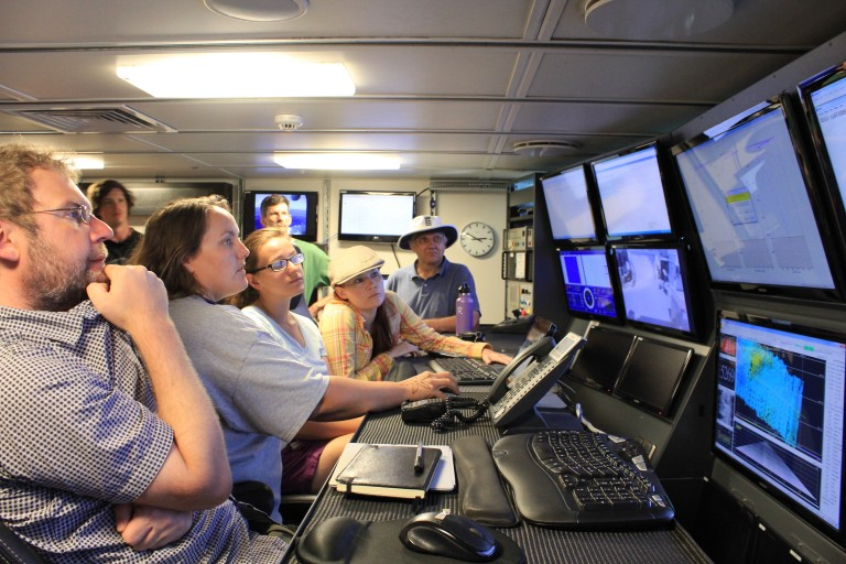 Lead Marine Technician Colleen Peters shows the science party how to work the video matrix in the control room.