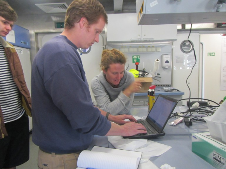 Amy Waterhouse and Sam Kelly prepare a computer that will download data from an ADCP deployed on the CTD rosette to measure water velocity.