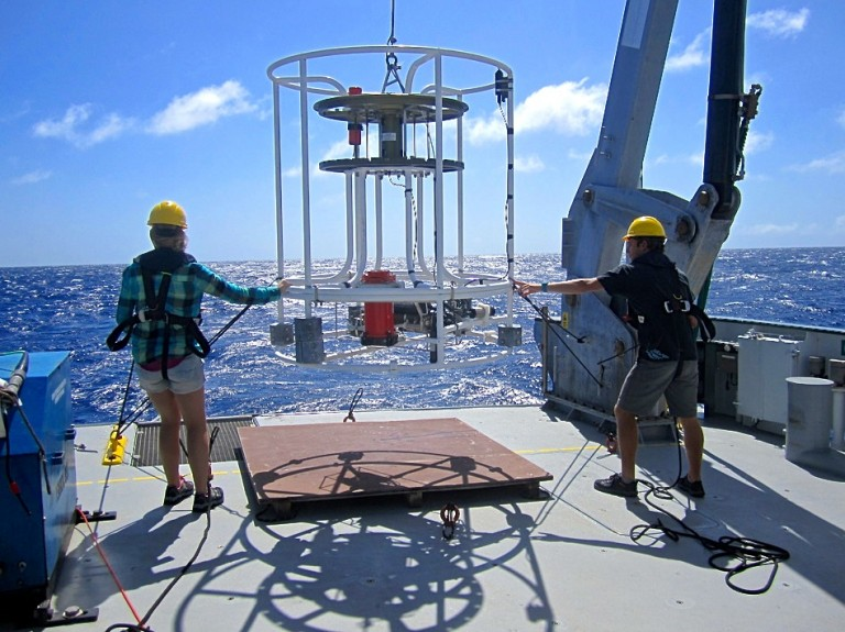 Caitlin Demers and Ted Conroy helping with deployment of the CTD (without sample bottles attached).