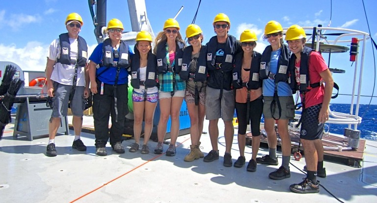 The student team, along with SOI marine technician Colleen Peters and Glenn Carter, chief scientist.