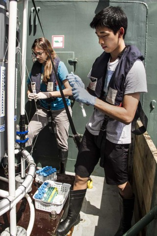 Caleb assists Dr. Alyson Santoro gathering water samples once the CTD rosette is back onboard.