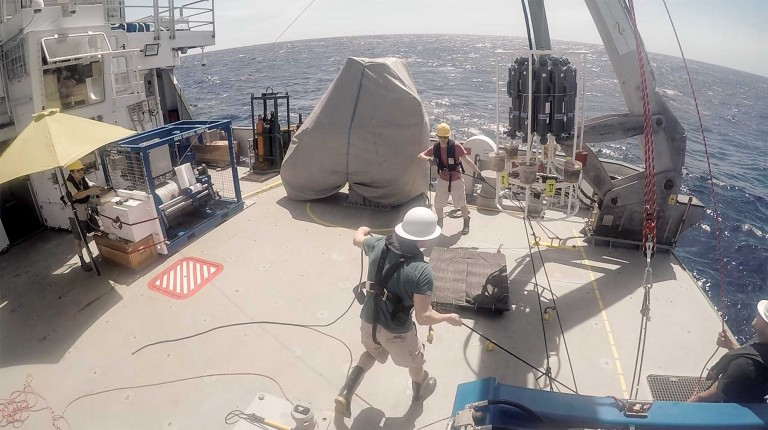 The team deploys the TMR (Trace Metal Rosette) from R/V Falkor's aft deck.