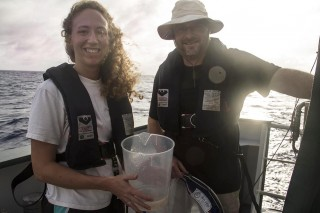 Erin McParland and Eric Webb after collecting plankton by towing a net at R/V Falkor's aft deck.