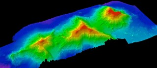 A 3-D view of three seamounts the team has imaged, from left to right they are unnamed, Academician Berg, and Turniff.
