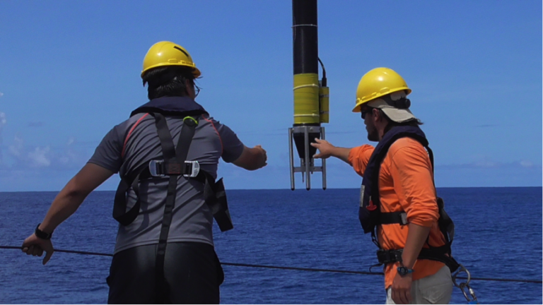Chang-Su Hong and Saulo Soares steady the VMP as it is deployed from the aft deck.