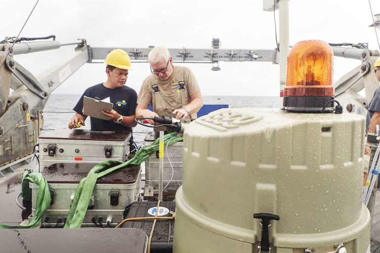Fitter Edwin Pabustan and Chief Engineer Allan Watt repair one part of the Sea Surface Scanner that was damaged while working.