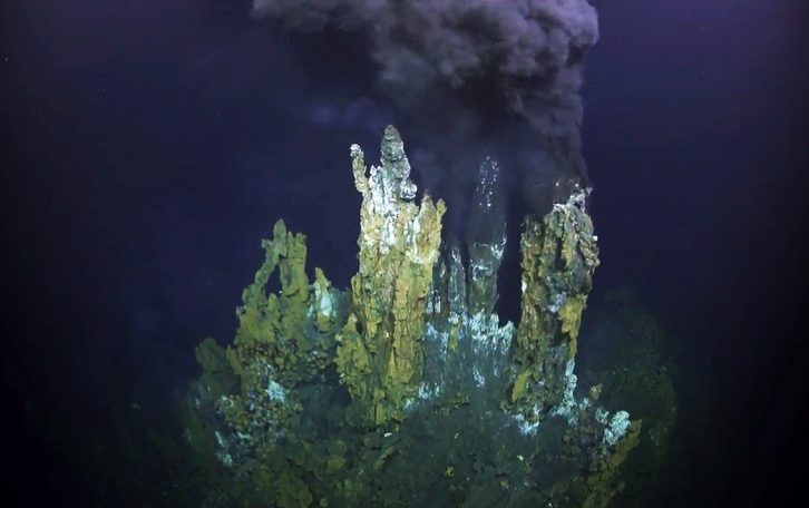 "This screengrab from an ROV ROPOS dive shows chimney structures and fluid release at a ""black smoker"" hydrothermal vent"