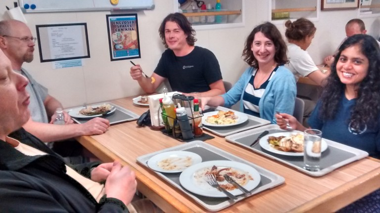 Meals are one time when everyone on the ship's schedule converges. Here, Michael and Ian from the ROPOS group dine with Jimbo the marine technician, and scientists Fanny and Arunima.