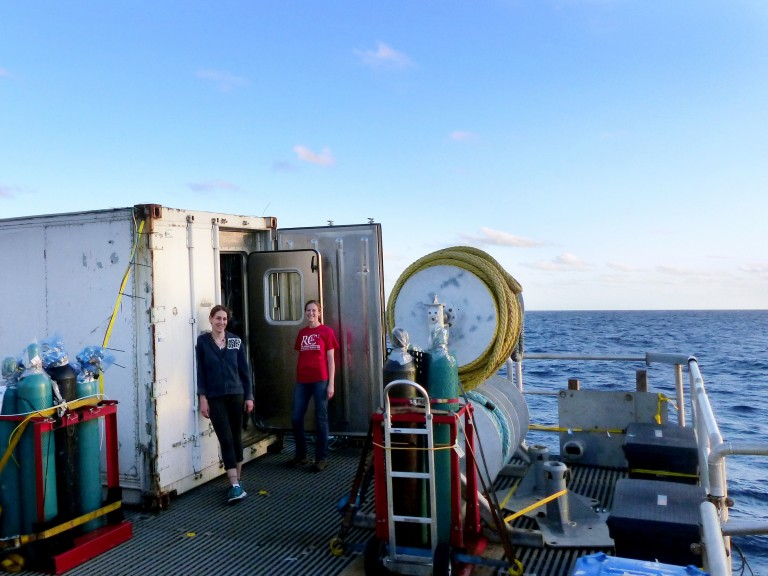 The pressure van is a custom-built mobile laboratory—housed in a 20-ft shipping container—which contains the infrastructure needed to keep deep-sea animals alive onboard the R/V Falkor. Jessica Panzarino (left) and Jennifer Delaney (right; blog author) will both work in the pressure van with live vent animals.