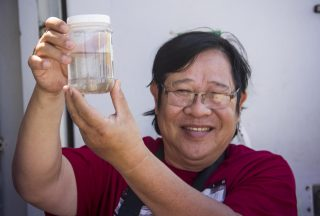 Dr. Lam Nguyen-Ngoc admires zooplankton collected in the first tow of the expedition