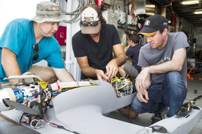 Joe McDaniel, Scott Bowers and Scott Brown respectively integrate scientific instruments into the Unmanned Aerial Vehicles. The data collected will provide information about processes affecting air-sea exchange.