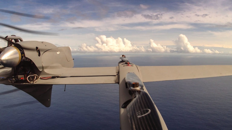 An HQ-60B drone flies over the Pacific Ocean, away from the effects that Falkor or clouds could have over data being collected. The aircraft flies an average of two hours in each mission carrying a payload of radiation, hyperspectral or infrared cameras.
