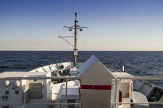 The aerosol sampler sits in the bow of R/V Falkor, automatically vacuuming the air and filtering it.