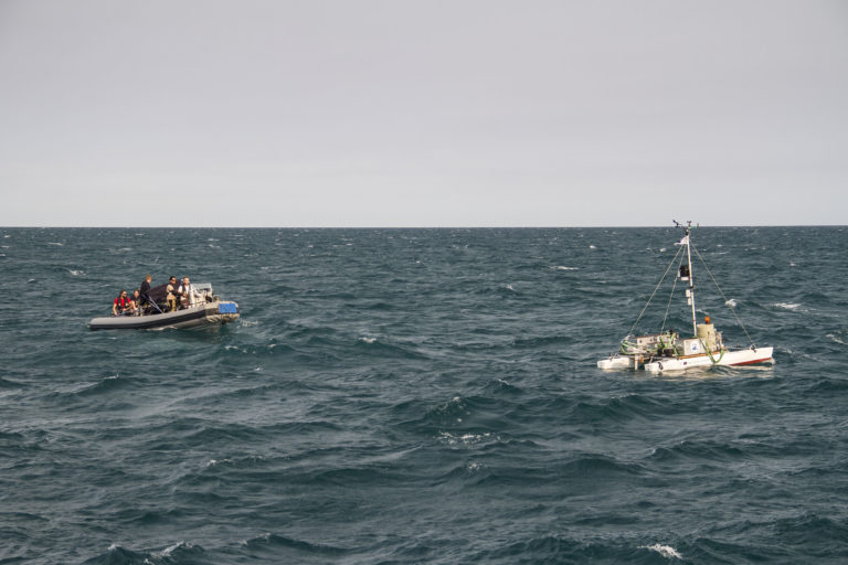 A remotely operated catamaran collects microlayer samples.
