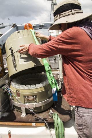 PhD student Ili Hamizah Mustaffa prepares the catamaran for its next deployment.