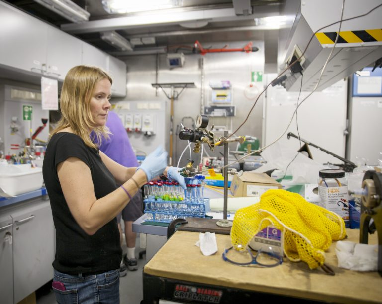 Microbiologist Julie Huber processing the latest vent fluid samples, in R/V Falkor's 'wet lab'