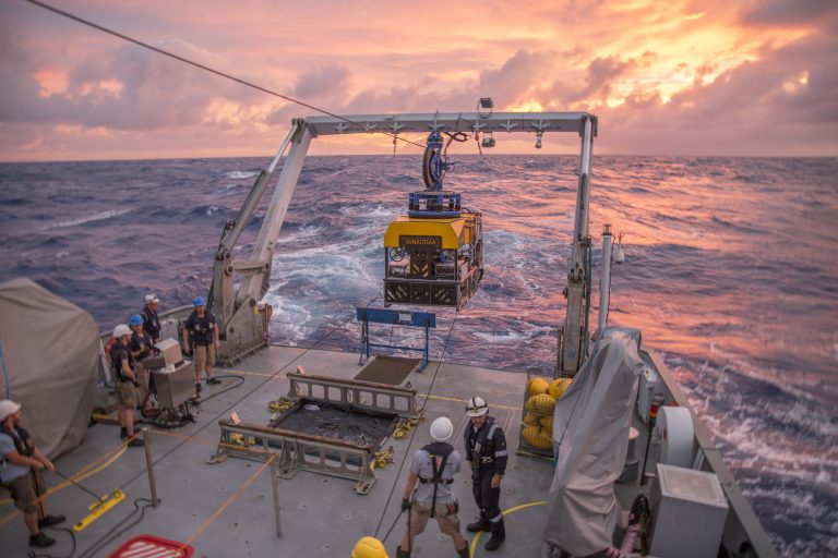 Crew of the R/V Falkor recovering ROV Sebastian under sunset in the Mariana Back-arc.