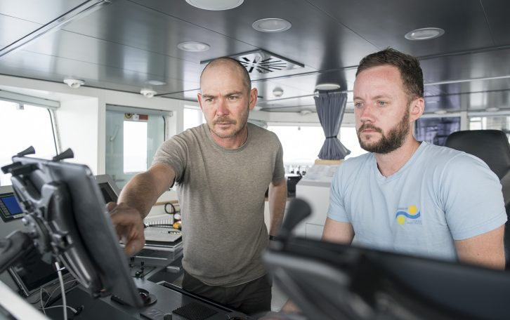 Dr. Oscar Pizarro and Navigation Officer Luke MacNutt keep track of the vehicles as tests and deployments run non-stop.