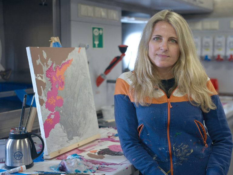 Rutstein in the studio she created onboard Falkor.