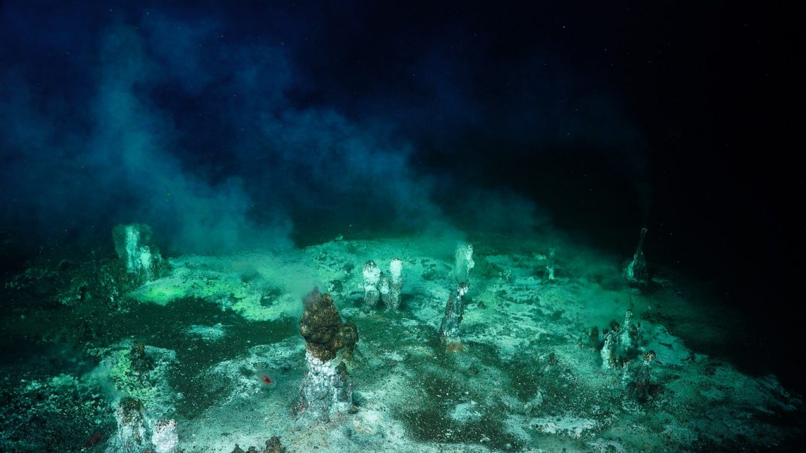 c7e48b3b A wide view of a field with a number of areas of diffuse flow, some noted  by several small (<1m tall) chimneys. ROV SuBastian / SOI