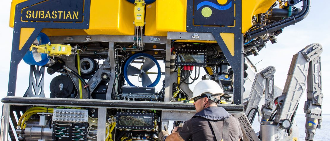 Michael Utley, bosun, helps position ROV SuBastian on deck after a recovery.