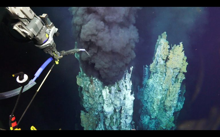 ROV SuBastian takes a fluid sample from a black smoker chimney during the December 2016 expedition.