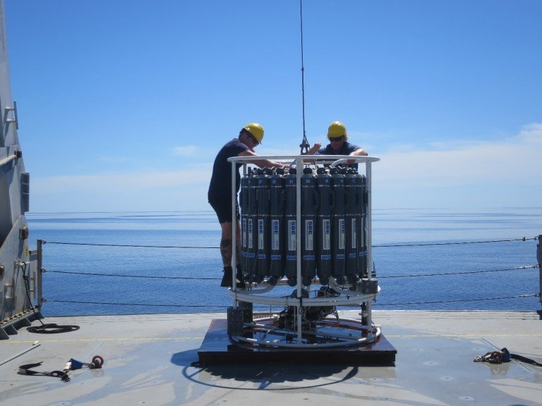 The science team prepares the CTD for deployment.