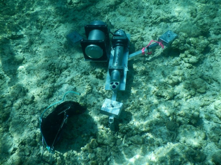 A frame deployed along the reef flat to measure temperature, water depth, and currents.