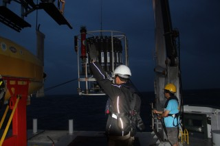 First Mate Philip and Ko-ichi deploy the CTD-rosette at first light this morning.