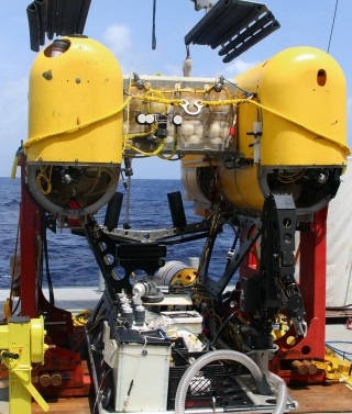 All dressed up and no place to go: Nereus with a basket full of sampling gear, ready for the dive that didn't (yet) happen.