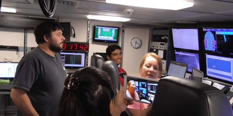 University of Houston masters student Vaughn Robla describes her duties as watchstander to students during a ship to shore connection.