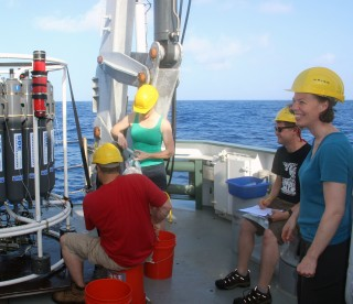 Fill yer boots! From left to right, Sean, Jill, Cody and Meg get started sampling the first CTD cast to come on deck this morning. By the end of the day, Meg's smile had not diminished but she was pretty much speaking in vowels only by the time she went to get some sleep.