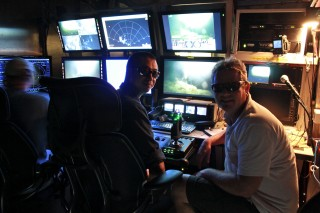 Chief Scientist Peter Etnoyer and ROV pilot Toshinobu Mikagawa wearing their 3D glasses in the ROV/AUV hanger.