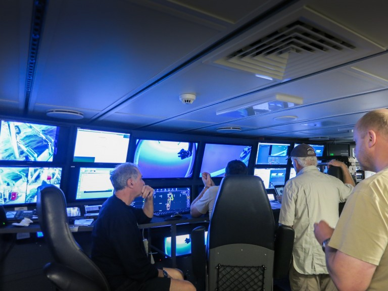 University of Western Australia Professor and Chief Scientist Malcolm McCulloch watches live footage in the control room from the first ROV test dive, along with the rest of the science team.