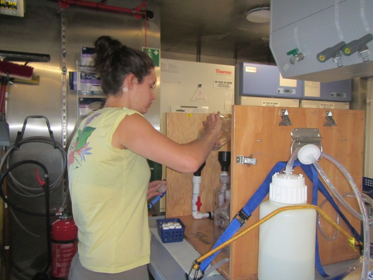 Danielle Mitchell filtering water samples.