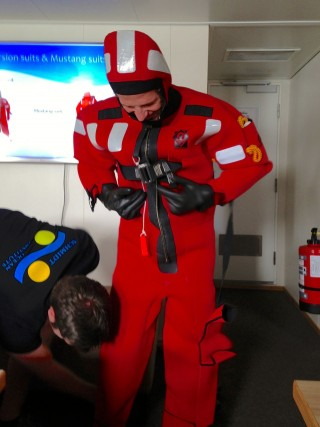 "Daniel Wagner tries on a ""Gumby"" survival suit."