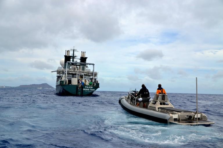 Falkor and the small boat Atreyu off the coast of Oahu.