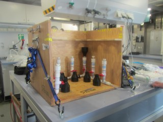 Pete Strutton's setup for filtering ocean water samples is strapped down in the wet lab.