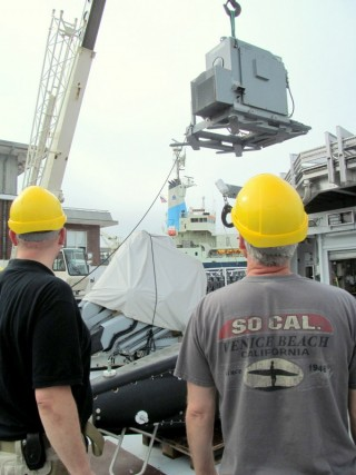 R/V Falkor crew and WHOI staff offload a winch that was used to operate the Video Plankton Recorder (VPRII).