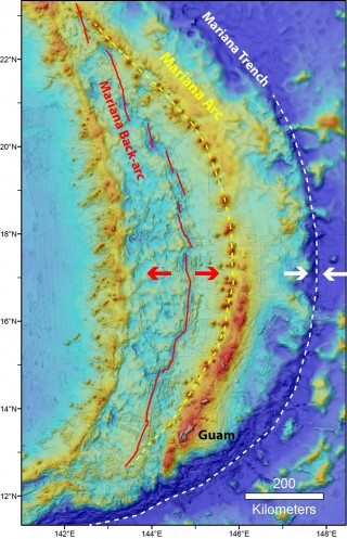 Map showing the locations of the Mariana Trench (white dashed line), Volcanic Arc (yellow dashed line), and Back-arc (red line).