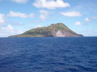 Sarigan island, part of the Commonwealth of the Northern Mariana Islands, is the top of an active volcano whose base is 3000 meters below sea-level.