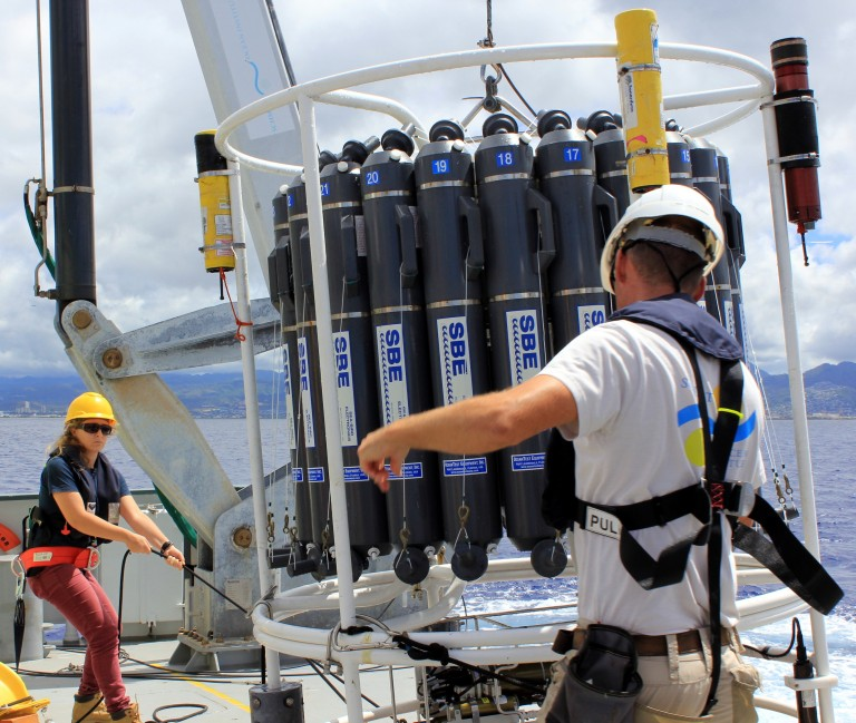 University of Hawaii graduate student Gabrielle Weiss learns how to secure the CTD rosette on the aft deck.