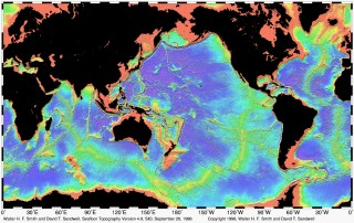 This image from Smith and Sandwell depicts the Seafloor Topography, a data set from which many mapping surveys are planned in areas with little or no multibeam data.