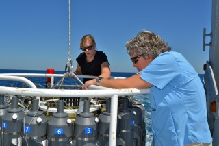 Maureen Trnka (left) and Harriet Nash (right) getting the CTD rosette ready for the next deployment.