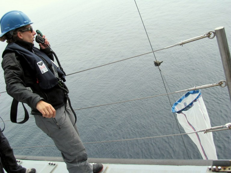Melissa Patrician, a researcher aboard the R/V Falkor's first shakedown cruise directs a  plankton net tow on July 17, 2012.