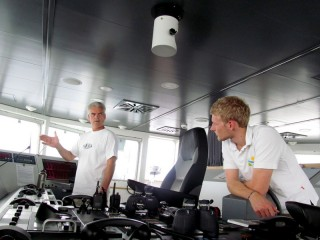 Dr. Cabell Davis (left), Chief Scientist aboard the R/V Falkor works with 2nd/3rd Officer Paul Shepherd to decide upon an ideal speed and heading for the next VPRII recovery.