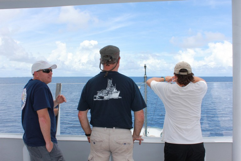 The science team looks at the horizon as Falkor travels to the first sample spot. They are eager for data to help fill the models and provide the answers they are looking for.